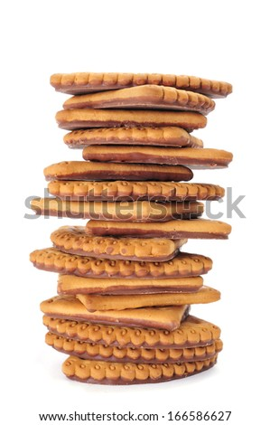 a pile of cookies chocolate-coated in the back on a white background