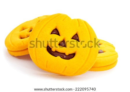a pile of cookies in the shape of jack-o-lanterns on a white background - stock photo
