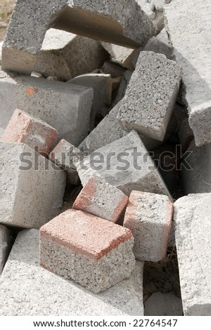 A pile of debris with concrete bricks - stock photo