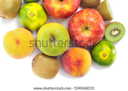 a pile of different fruits, as apples, peaches, oranges or kiwis