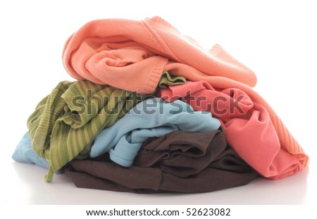 a pile of dirty clothing isolated on white background - stock photo