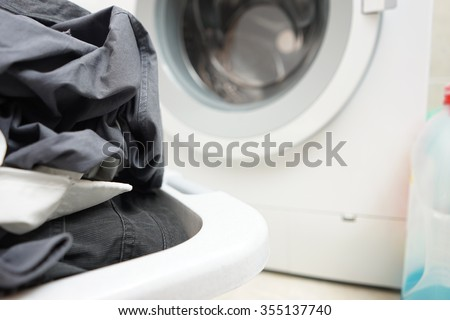a pile of dirty laundry waiting to be washed in a washing machine - stock photo