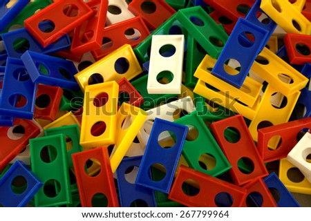 A pile of domino stones like kids use them to play domino show where dominoes are set up in long lines to create a chain reaction when they fall or topple - stock photo