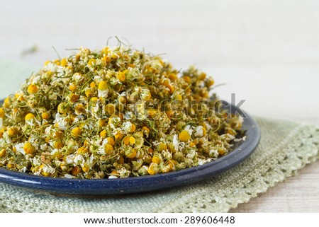 A  pile of dried chamomile flowers  - stock photo