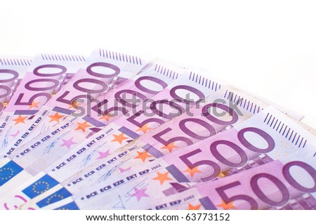 A pile of euro banknotes scattered around