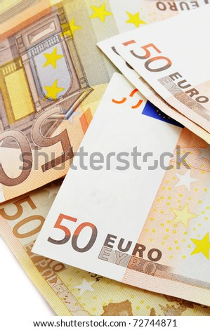 a pile of 50 euros bills on a white background - stock photo