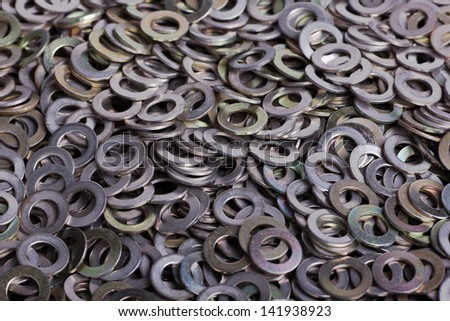 A pile of flat metal shims