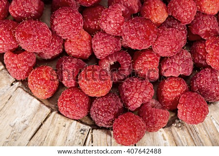 A pile of fresh, colorful red raspberries - stock photo