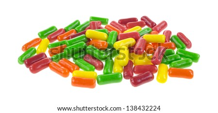 A pile of fruit flavored chewing gum on a white background.