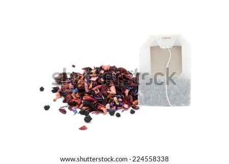a pile of fruit tea and a tea bag on white - stock photo
