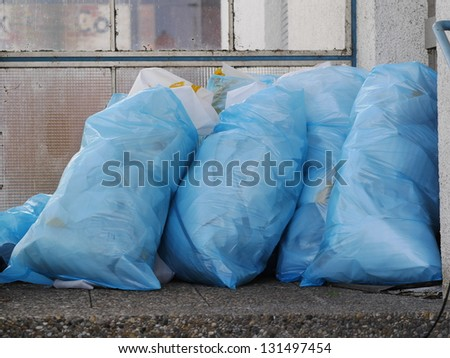 a pile of full garbage bags in a dump - stock photo