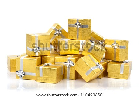 A pile of gold gifts on white background - stock photo