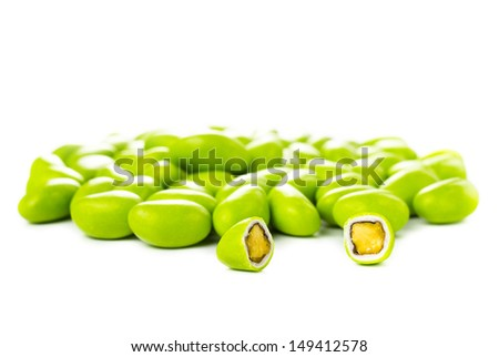 A pile of green gumballs with nuts isolated  on a white background.  - stock photo