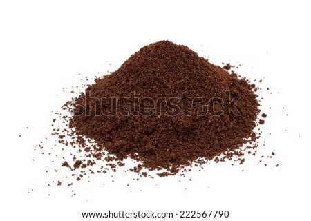 A pile of ground coffee isolated on white - stock photo