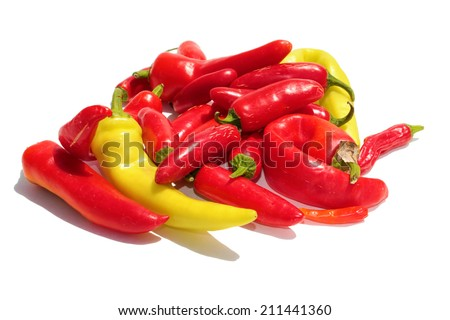 A pile of Hot Peppers of different types in Red and Yellow, isolated on white with room for your text. Hot Peppers are filled with vitamins and chemicals used by people and industries around the world - stock photo