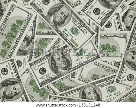 A Pile of Hundred Dollar Bills as a Money Background - stock photo