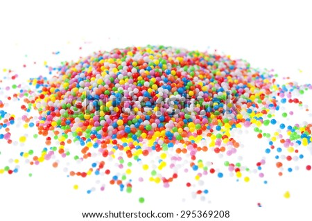 A pile of hundreds and thousands sprinkles on a white background.