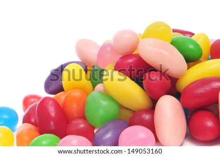 a pile of jelly beans of different colors on a white background - stock photo
