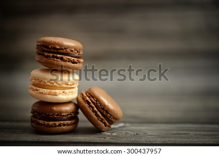A pile of macaroons on dark wood background