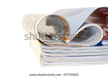 A pile of magazines on white background