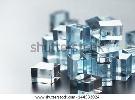 a pile of many little glass cubes, beautifully reflecting each other - stock photo