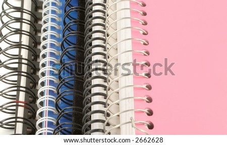 a pile of metal ring binder notebooks