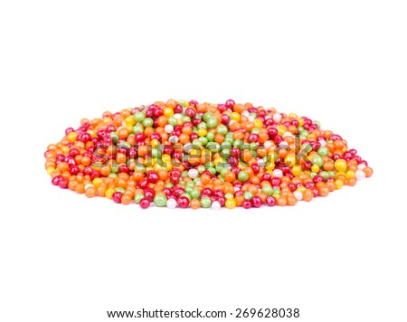 A pile of multicolored little candies on a white background - stock photo