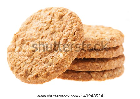 a pile of oats biscuits on a white background - stock photo