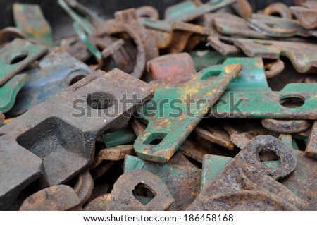 A pile of old metal farm parts now rusting away and ready to be used as scrap metal.  - stock photo