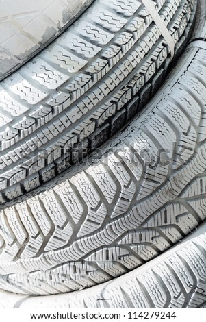 A pile of old tires painted white - stock photo