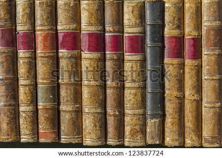 A pile of old weathered books - stock photo
