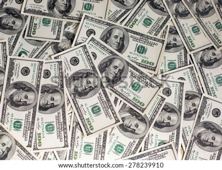 A pile of one hundred dollar bills - stock photo