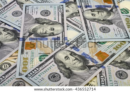 A pile of one hundred dollar bills as background. - stock photo