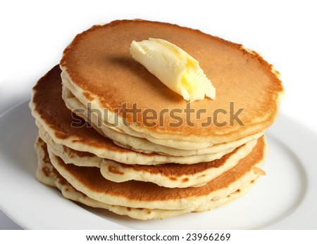 A pile of pancakes with a dollop of butter