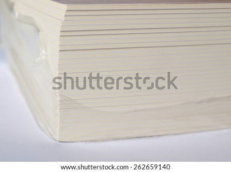 a pile of paper brochures - cut side - stock photo