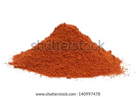 a pile of paprika powder on white - stock photo