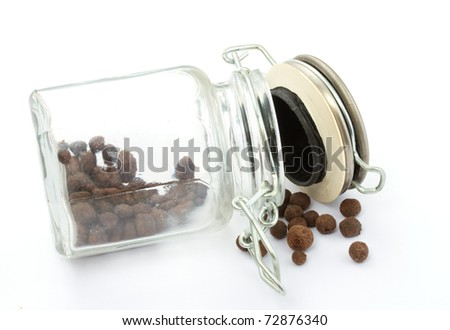 a pile of peppercorns in the bottle isolated on white