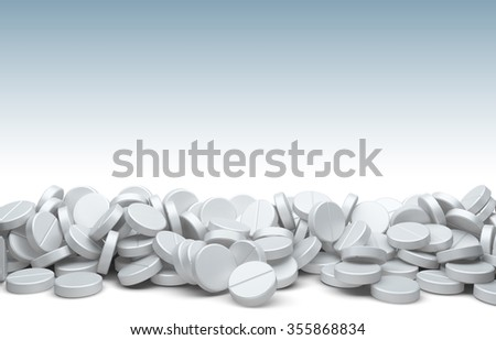 A pile of pills and tablets isolated on a white background