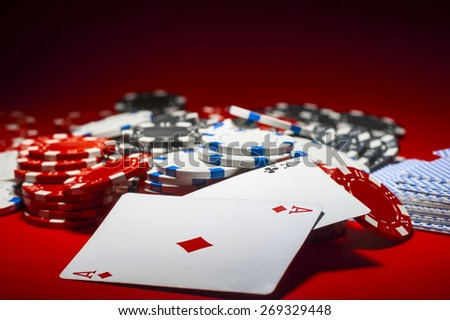 a pile of poker chips and a pair of aces - stock photo