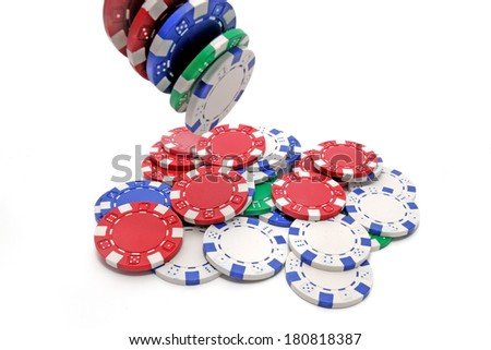 A pile of poker chips, or Casino tokens, isolated on white background. Four of them are flying, thrown by someone.