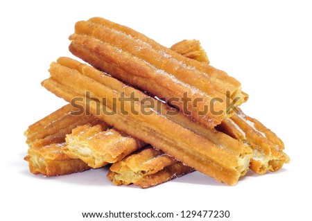a pile of porras, thick churros typical of Spain - stock photo