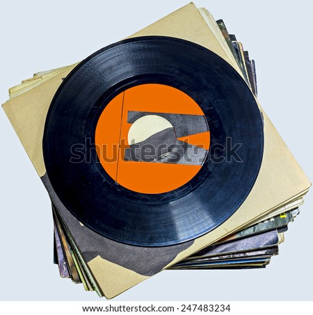 A pile of 45 RPM vinyl records used and dirty even if in good condition - stock photo
