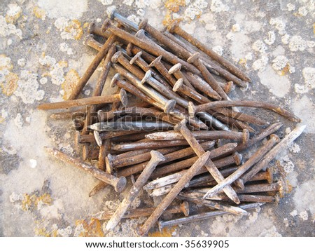 a pile of rusty nails - stock photo