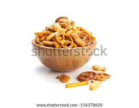 A pile of salted mixed party snacks background. - stock photo