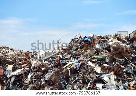 A pile of scrap metal waste in a recycling yard