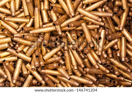 A pile of shot 5,56 mm bullet casings - stock photo