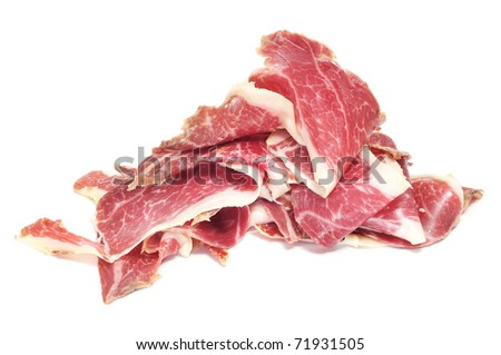 a pile of slices of spanish serrano ham on a white background