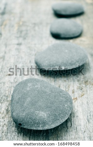 a pile of stones on an old wooden surface