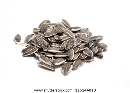 a pile of sunflower seeds isolated - stock photo
