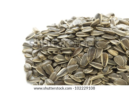 A pile of sunflower seeds on white background